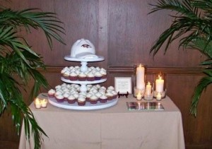 check out the Grooms cake which was done by Elaines Creative Cakes.  If you can believe it, the hat at the top of the cupcake stand is an actual cake!!!  The Groom is a huge NFL Baltimore Ravens fan so they wanted to incorporate that but in a very unique way...it turned out perfect!