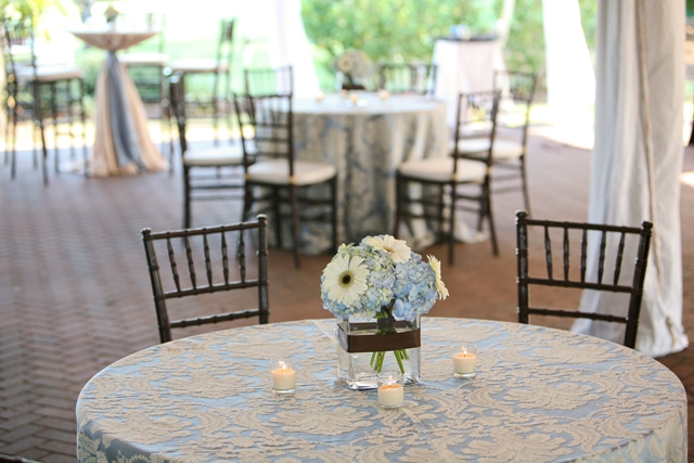 We found beautiful blue & ivory damask linens that just went with our crystal chandeliers like...peas & carrots!  :)