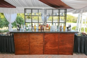 Erin's Family was all about the bar so Snyder Event Rentals mahogany bar & shelves were perfect!